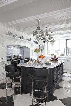 Elegant black and white Surrey kitchen by Maurizio Pellizzoni, shot for The English Home Magazine