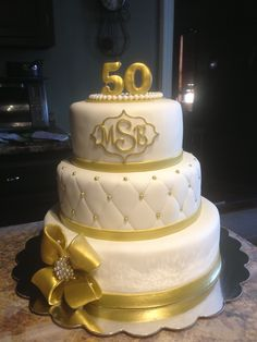wedding anniversary cake i made! Mallory Gray 50 Cakes of… Golden Anniversary Cake, 50th Wedding Anniversary Cakes, Anniversary Ideas, 50th Birthday Cake Designs, Gold Birthday Cake, 50th Cake, Cake Decorating With Fondant, Themed Cakes, Facebook Instagram