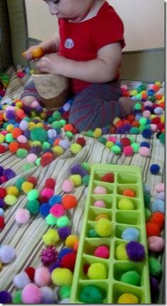 sensory play inside a playpen via Little Hands Big Work (close supervision needed for this activity)