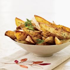 Oven Fries with Roasted Garlic Recipe on Food & Wine. The Good News Skin-on potatoes, like the ones used for these crispy, low-fat fries, are high in vitamin C and potassium; they're also a good source of dietary fiber and vitamin B. Potato Sides, Potato Side Dishes, Vegetable Side Dishes, Main Dishes, Garlic Recipes, Potato Recipes, Passover Recipes, Passover Menu, Fries In The Oven