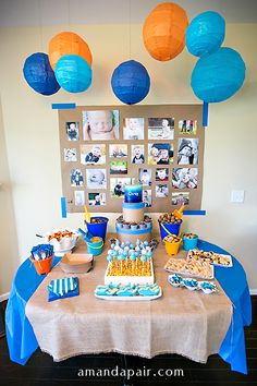 ocean-themed-first-birthday-party I like the picture display as a backdrop!