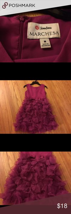 Marchesa Neiman Marcus Girls M Dress This is for a cute little fashionista! Marchesa Neiman Marcus for Target girls dress, size M (7/8). The color is a maroon or raspberry. Worn 1-2 times, in great shape. Marchesa Dresses