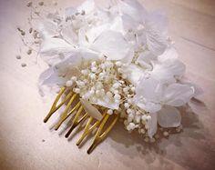 Pik of preserved white hydrangeas and broom