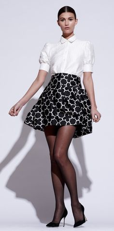Pink Tartan! One of Canada's more recognizable women's wear brands. Designed by Kimberly Newport-Mimran she's known for designing shirt dresses, full pleated skirts, sweater sets and always fun prints!  Short Puff Sleeve Blouse and Quatrefoil Skirt