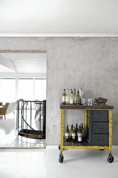 Remodelista-Industrial-bar-carts-yellow-wood-single-file-cabinets