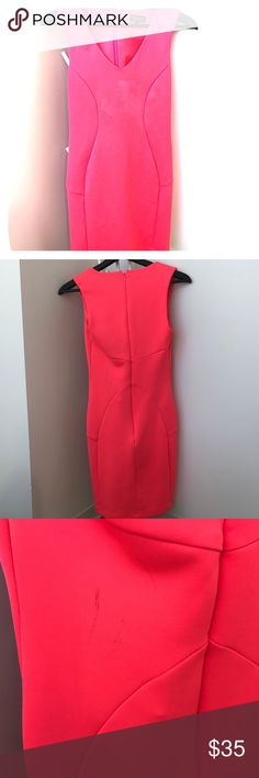 Neon pink scuba top shop dress This dress is super cute, but I don't wear it enough. It's a v neck, hot pink, and a scuba material. Super body con and comfortable. There is some black markings on the back, that may have happened during my moving process, and will likely come out with a wash. Topshop Dresses Mini