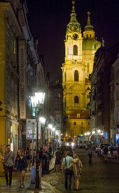 St. Nicholas church in Prague at night from Mostecka Street