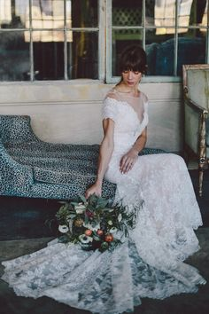 This lace Watters wedding dress has our hearts | Image by Loreto Caceres Photography