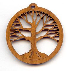 21637  Laser Cut Cherry Wood Tree of Life Pendant, each  What could be more beautiful than an intricate laser cut tree of life pendant.  Tree designs truly go with anything and are so popular right now.  This pendant is laser cut from cherry wood right here in the USA.  Use this pendant with gemstones or other wood beads.  They are also a good size for earrings that make a statement.