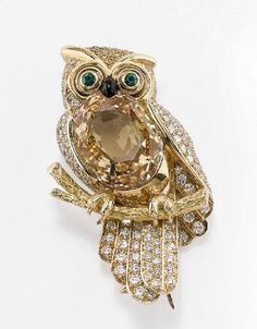 CARTIER A TOPAZ, COLOURLESS AND COLOURED DIAMOND OWL BROOCH, SIGNED CARTIER - Christies