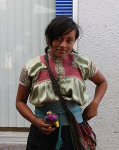 Chiapas girl with a wool turtle she's made