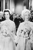 In the final double wedding scene of Gentlemen Prefer Blondes, Marilyn Monroe and Jane Russell walk up the aisle in matching dresses, created by costume designer Travilla.