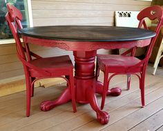 Red painted and glazed clawfoot round pedestal oak dining table with a ebony stained top for lovely outdoor dining table