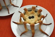 "Tentacle Pot Pies: Almost Too Cute to Eat (from NotMartha.org) ""This is an easy and slightly creepy Halloween dinner. I very simply cut dough into long strips to create tentacles that drape down the sides of a bowl. It's awfully fun to break off tentacles and dunk them into the pot pie while eating."