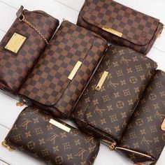 Louis Vuitton Handbag Neverfull GM-- since everyone has the regular LV print. This one is a little more subdued.