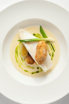 Tom Brown's stunning grilled lemon sole recipe is served with a host of fresh flavours, including a vibrant green tarragon oil.
