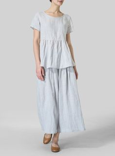 Linen Short Sleeve Pleated Blouse - Dress to impress in this beautiful breezy top fabricated from natural linen. Neatly pleated and flares out from the waist.