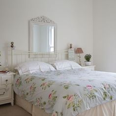 Bedroom with decorative mirror