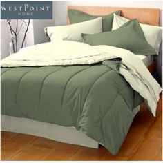 Solid Comforter reversing into two coordinating colors. 70% Polyest...