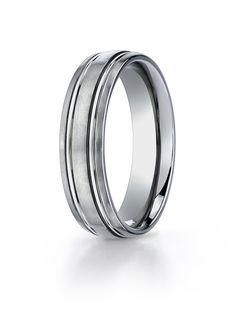 Men's Wedding Band TICF56444 - Men's Titanium Wedding Band TICF56444 General Information: Metal: TitaniumComfort Fit: YesWidth: 6 mmFinish: Spin Satin