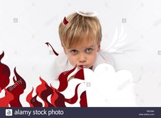 Naughty or good child for Christmas card? PF or letter to Santa-Claus for Christmas. Little child boy appearing as an adorable angelic devilStock Photo Little Children, Santa Letter, Kids Boys, Devil, Christmas Cards, Angel, Lettering, Stock Photos, Christmas E Cards