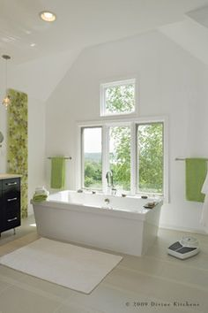 gorgeous bathroom with windows, love the contrast of white and green with dark brown cabinetry