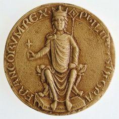 PHILLIPVS DEI GRATIA FRANCORUM REX (« Philippe, par la grâce de Dieu roi des Francs »).Sceau de Philippe Auguste : on note la fleur de lys dans la main droite.