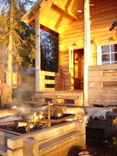 Log Cabin on its own island in Lapland, love the homemade built in grill