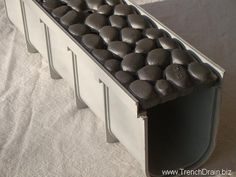 riverrock, plastic trench drain, trench drain system, iron grate, cast iron grating