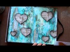 Timelapse video of my latest mixed media project - Working in my Moleskein journal    Products used: Golden Gesso, Golden Fluid acrylic paints, Lumiere Paint, Viva Ferro Paint, Book Page, Ranger Glue & Seal, Golden Soft Gel Medium, Derwent Charcoal Pencil, Harlequin Stamp (By Stampin' Up).