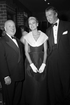 Alfred Hitchcock, Grace Kelly, and Jimmy Stewart at the premiere of REAR WINDOW (1956)