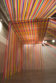 E&E The installation, by artist Megan Geckler, is made up of thousands of strands of flagging tape, a non-adhesive plastic ribbon that surveyors use to mark off construction sites.