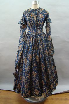 """Pretty Print 1840's Dress for Study or Repair, wool barege, polished cotton lining, waist: 28""""; bust: 31""""; hand stitched, piping at neck, dropped shoulder & waist, five decorative threat covered buttons remaining, hook & eye closure; hem bound with self fabric, faced with blue material about 5"""" up, pocked on right front side."""
