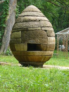 Anne Reichardt's Peace & Serenity Stroll Garden. Fayetteville, ARK. Carved 9' natural-rock egg cairn with chamber. This garden was established to honor the natural character of the rural Arkansas landscape while incorporating Soto Zen accents.