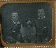 Two young gentlemen with a good sized dog.    eBay Auction, December 2011