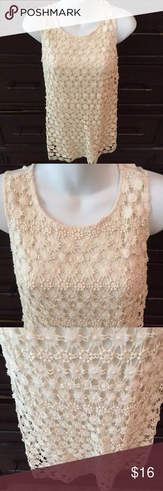"""INC ivory knit tank top with crochet front overlay Very pretty INC from Macy's ivory dressy tank top in rayon with cotton crochet overlay. Great for dress or casual wear in a size small. Has a key hole opening in the back with fabric button. Size small and measures across the chest laying flat is approx. 16.5"""" with some stretch and length of top measured in the back is 24"""". From a smoke free home. INC International Concepts Tops Tank Tops"""