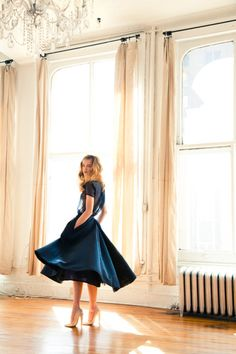 The big windows, the flowy dress, the old radiator, the chandelier; what isn't to love about this picture?