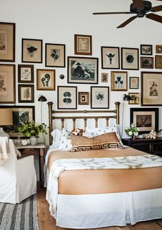 To keep a gallery wall from feeling haphazard in your bedroom, pick an overarching theme or color.