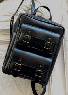 Handmade leather Backpack DOS ........ 2 sizes ...... 2 choices ...... same quality !!!!! Always black  !!!! Romba's leather sandals, bags, tobacco pouches, lighters cases, notebooks and more