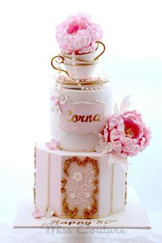 Love the teacups on top of cake