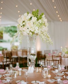 Tall White Centerpieces // Marisa Holmes Photography // TheKnot.com