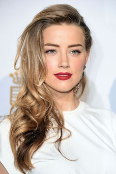 Amber Heard- Honey highlights warm up a taupe base, makeup isn't half bad either...