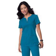 The koi Sapphire Mara Top in Ultramarine. Sleek, stylish and comfortable. Try today for only £29.99.  #medicalscrubs #nursescrubs #dentistscrubs #nurses #dentists #bluescrubs #nurseuniform