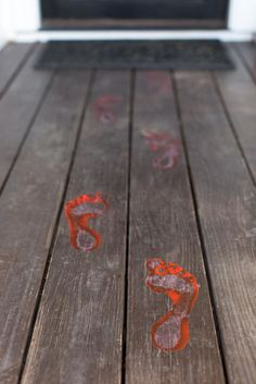 Greet trick or treaters with bloody footprints leading up to your door. http://www.diynetwork.com/how-to/make-and-decorate/decorating/2015-pictures/front-yard-decorating-ideas-for-halloween >>