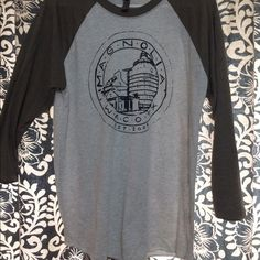 Magnolia Market Seal Baseball T - Never Worn Do you watch fixer upper with Chip & JoJo?? Well I do and visited their magnolia market store at the silos in Waco,TX! Unfortunately I got this shirt in the wrong size and they don't have one on the website to order the right size!!  Super soft, never worn and I'm so sad I can't wear it!! But if you can - get it now! Can only be bought at the store, not available online. Tops Tees - Long Sleeve