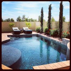 Remodeled pebble tech pool with integrated spa added for Pool design by laly