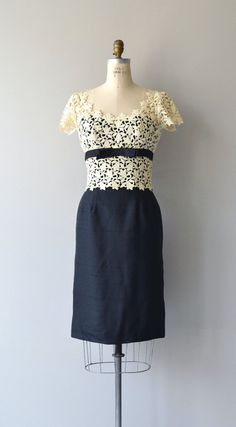 Vintage 1950s black raw silk cocktail dress with ivory cotton lace bodice trimmed with black bodice bow, fitted waist, V back, short sleeves, full
