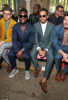 Fashionable friends: Lewis caught up with his pal Tinie Tempah at the Richard James showca...