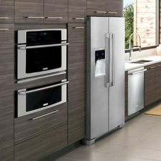With light wood cabinets.             Electrolux vs GE Monogram Wall Ovens (Reviews/Ratings/Prices)