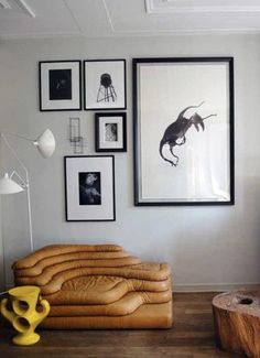 black & white gallery wall | awesome vintage leather chair